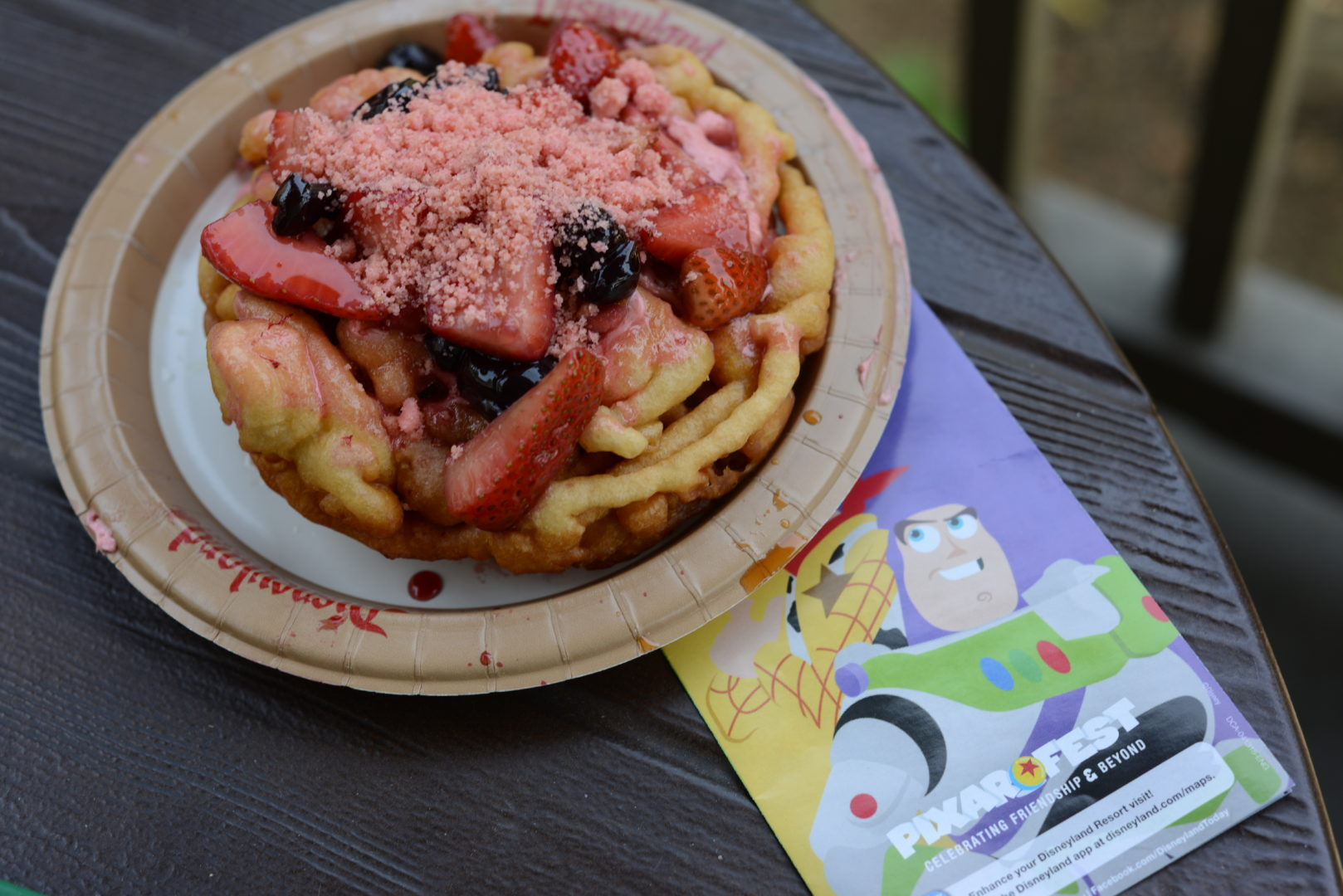Lots-O Strawberry & Blueberry Funnel Cake with a Disneyland/Pixar Fest Park Map