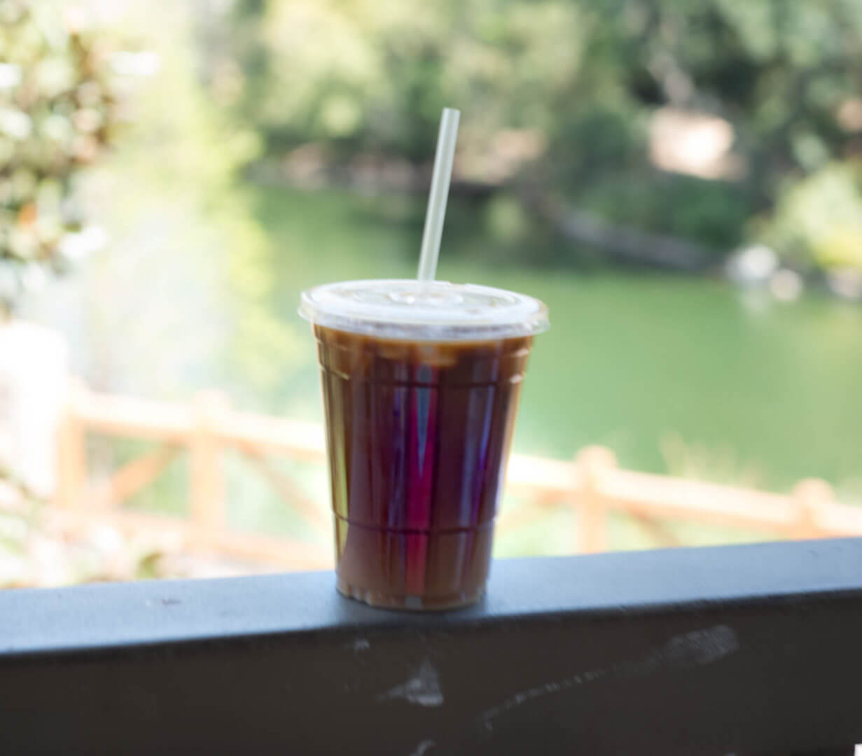 Specialty Cold Brew from Hungry Bear in front of Tom Sawyer Island | Where to Find Good Coffee at Disneyland