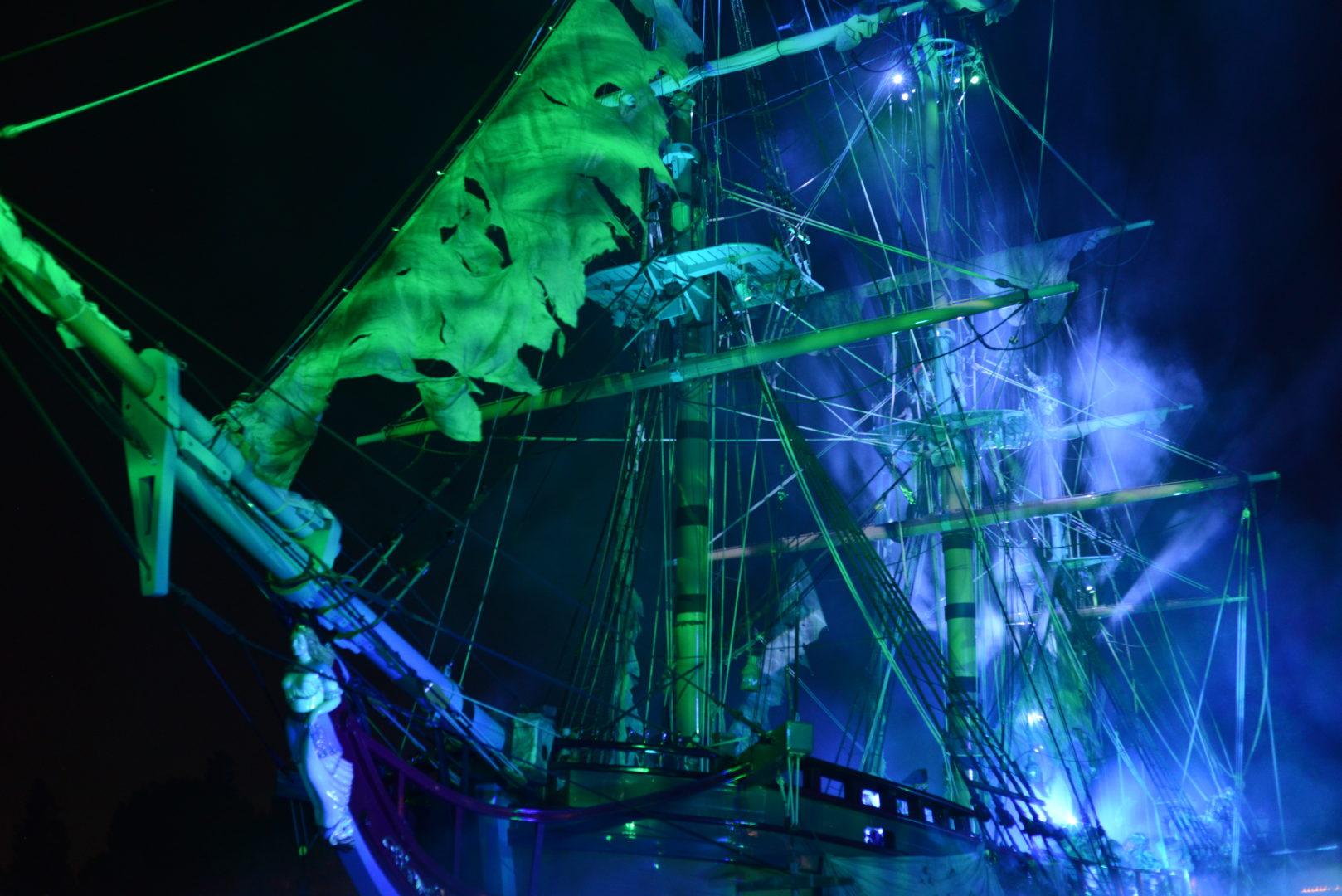 Blue and Green Pirates of the Caribbean Ship at Disneyland's Fantasmic Night Show