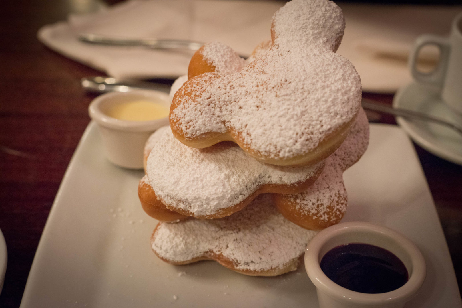 Stack of Mickey Shaped Beignets with Powdered Sugar at Carnation Cafe in Disneyland