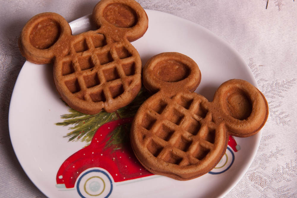 Two Pumpkin Spice Mickey Waffles on a Holiday Plate | Disney's Very Merry Christmas Party Recipe
