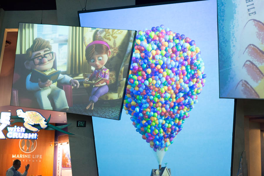 Scene from Pixar's Up - Carl and Ellie Holding Hands and Balloons at Disneyland's Animation Courtyard