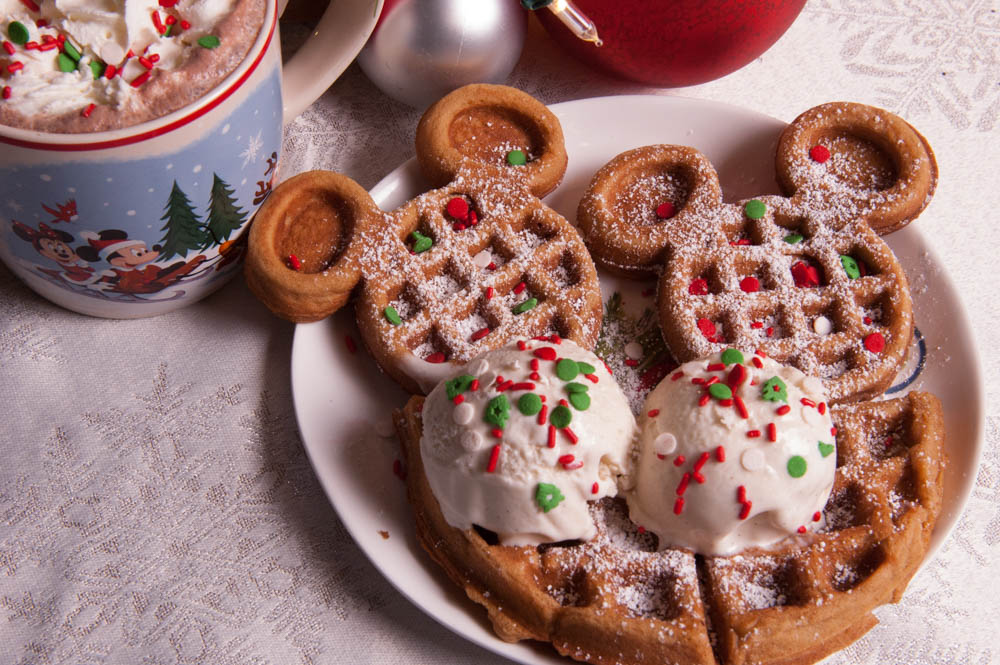 Mickey Shaped Pumpkin Spice Waffles with Ice cream, Sprinkles, and hot cocoa. Christmas Party recipe.