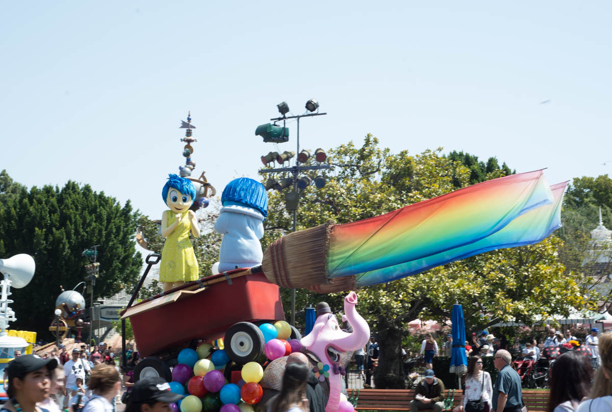 Joy and Sadness from Inside Out Pixar Play Parade Float at Pixar Fest in Disneyland