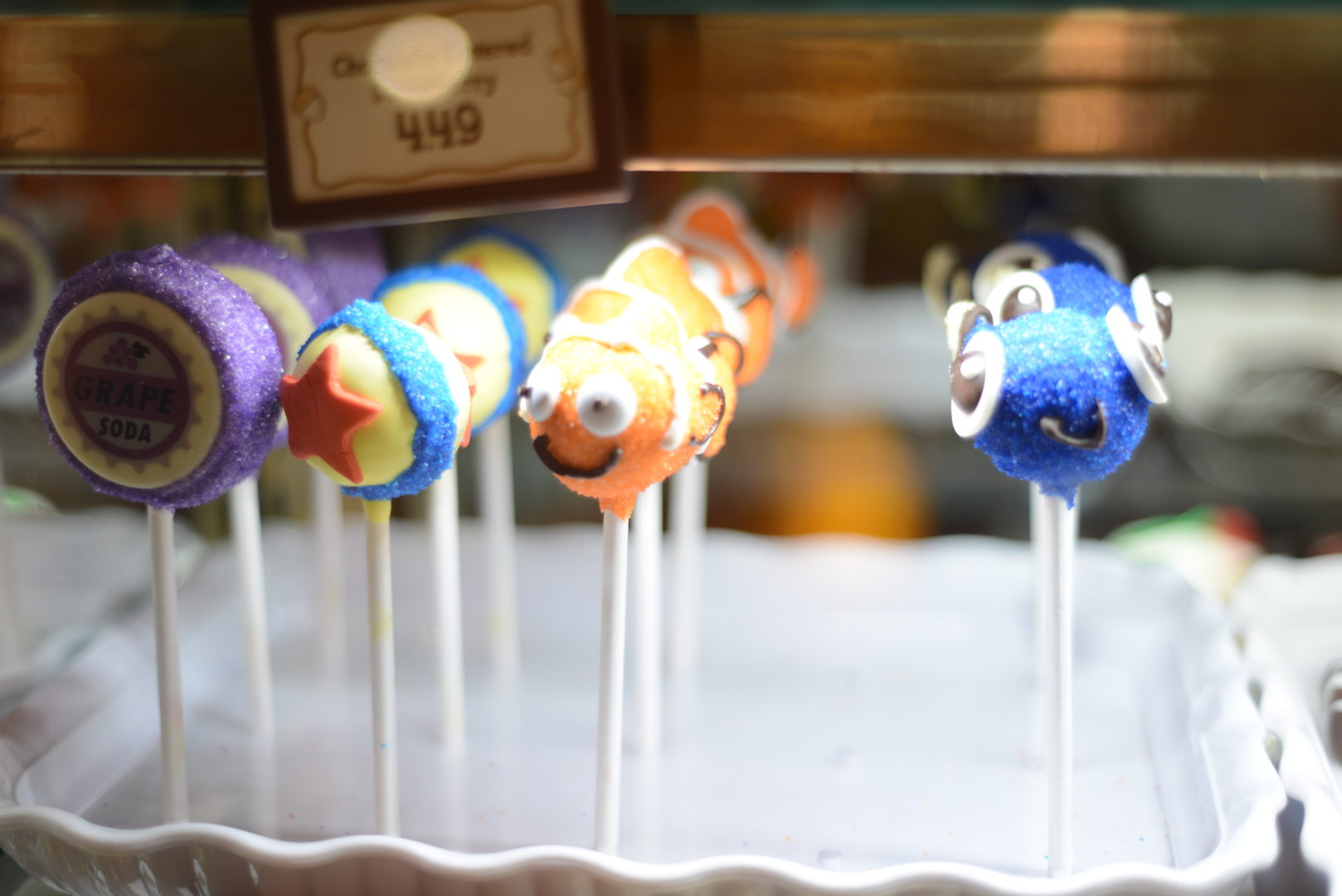 Finding Nemo and Luxo Pixar Cake Pops in a Display Case at Disneyland's Pixar Fest