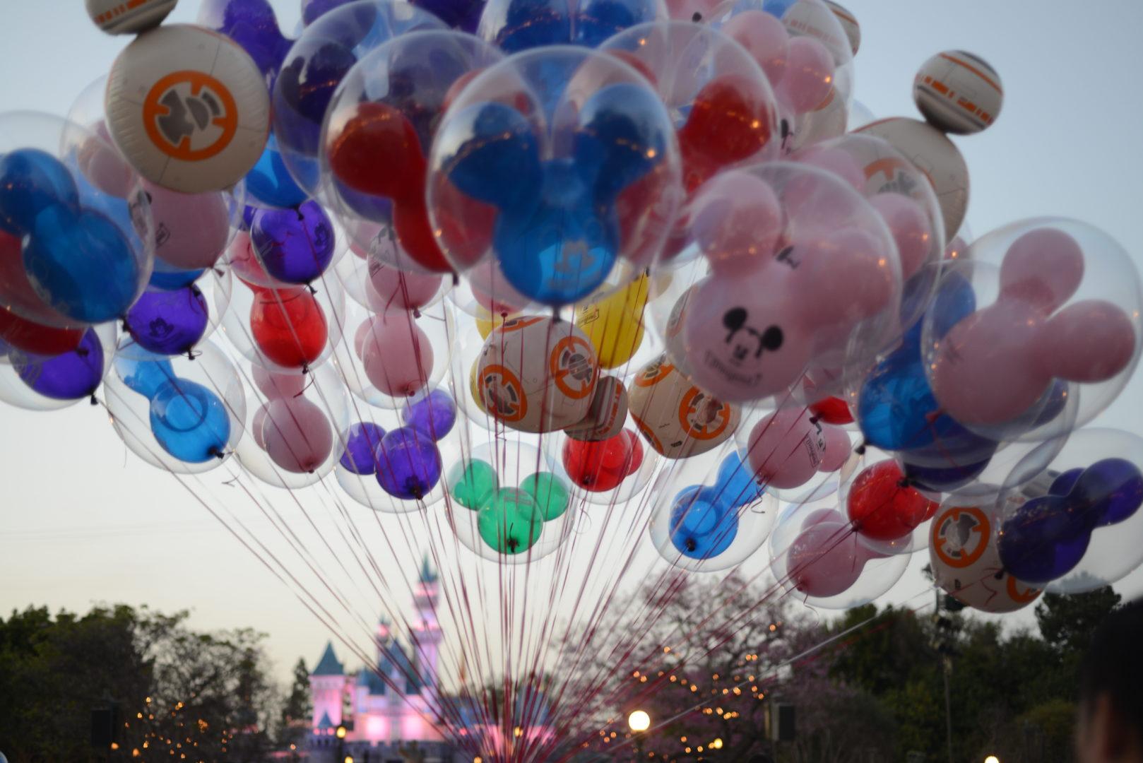 Huge Bouquet of Disneyland Balloons in front of Sleeping Beauty Castle at Dusk