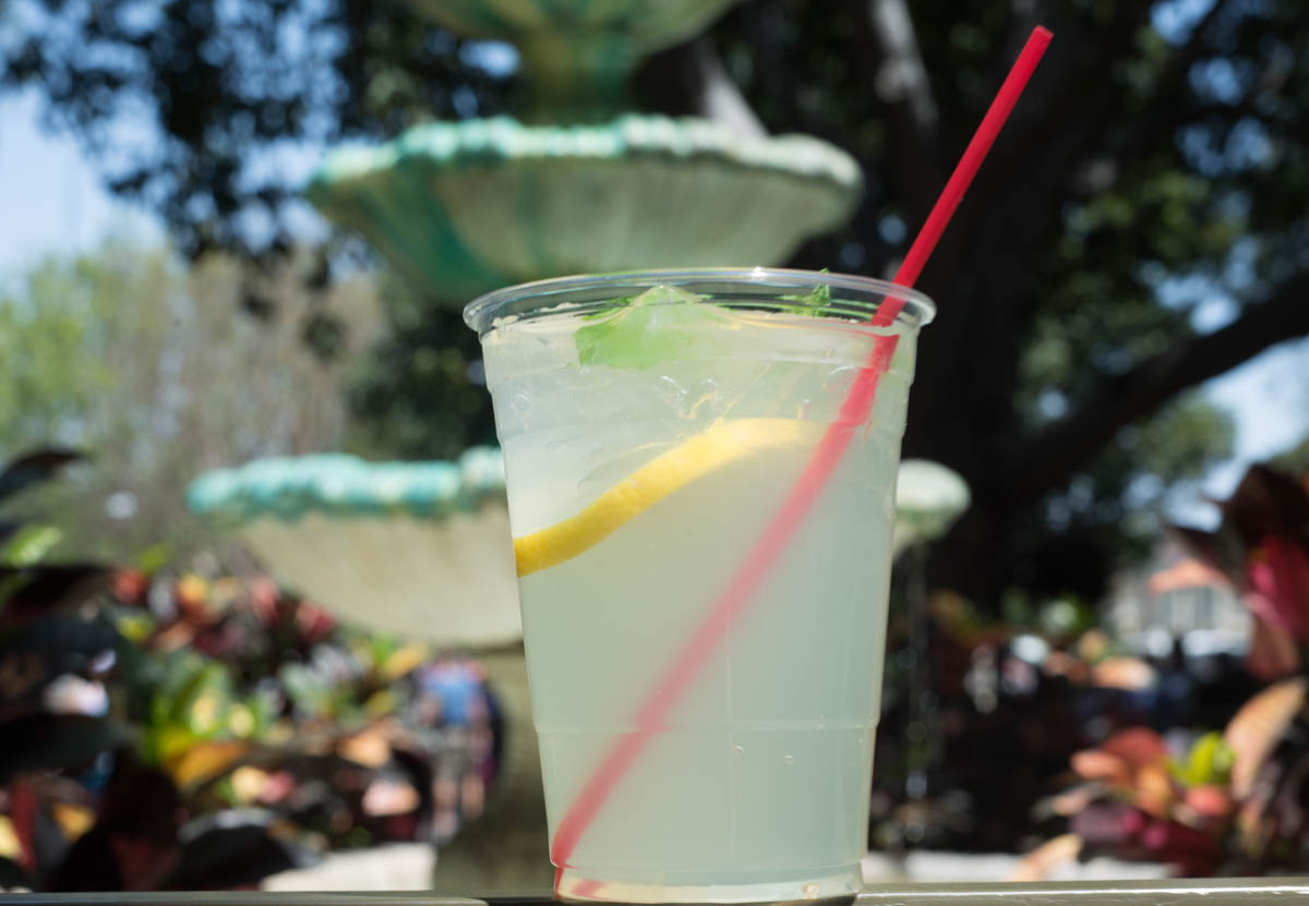 Mint Julep Drink with a Lemon Wedge in front of New Orleans Fountain in Disneyland
