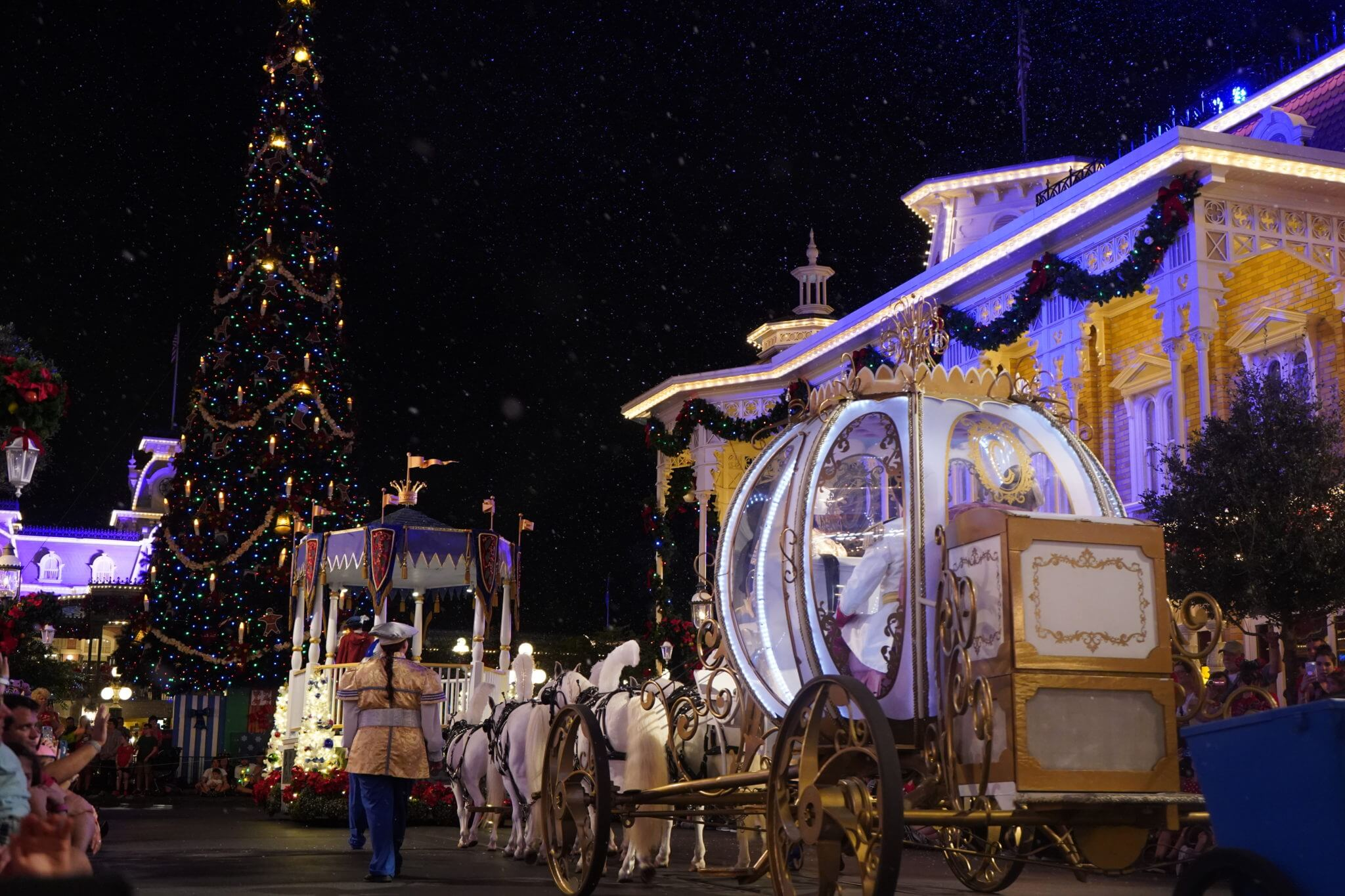 Cinderella Carriage and Christmas Tree in Once Upon a Christmastime Parade on Main Street USA in Disney World